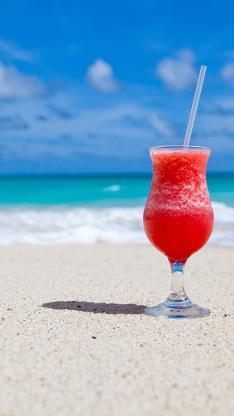 海滩 饮料 加勒比海 鸡尾酒 异国情调 玻璃杯 度假海岸 沙滩 红色蓝色 海洋