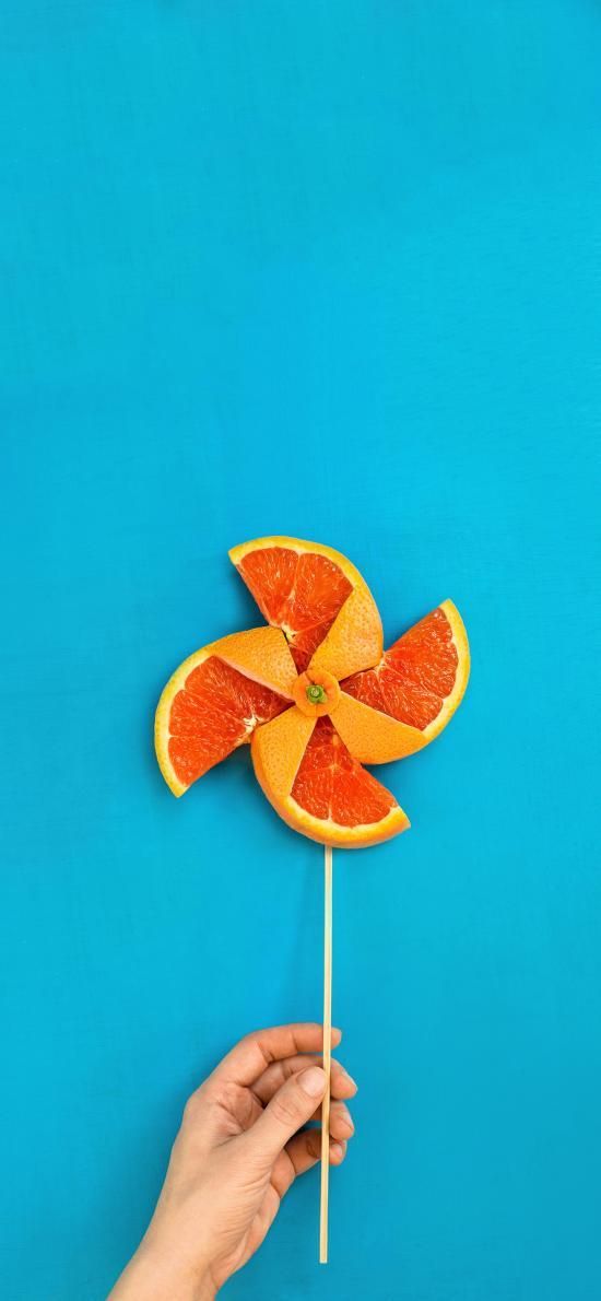 风车 蓝色 橙子 手 组合 设计