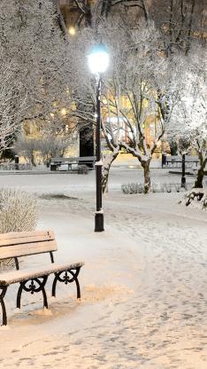 冬天 雪地 下雪 白色 椅子 路灯