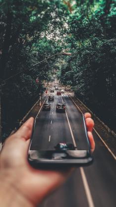 马路 行驶 车辆 手机 道路
