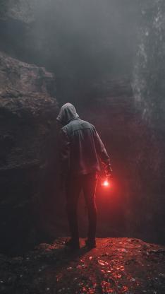 背影 灯光 红光 岩石