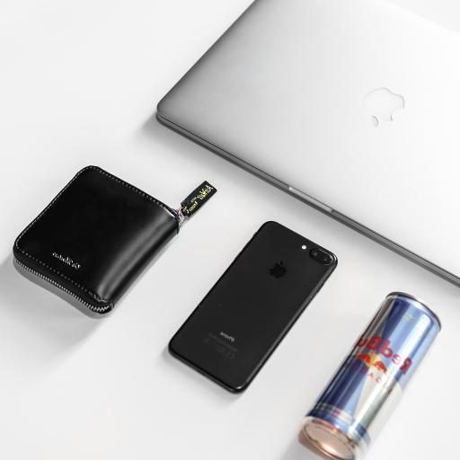 静物 笔记本 钱包 手机 红牛