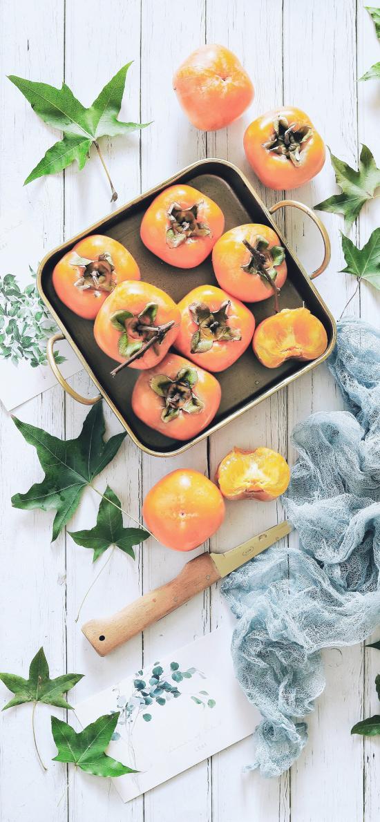 盘子 水果 柿子 绿叶