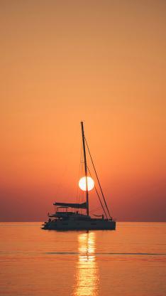 大海 船只 夕阳 唯美