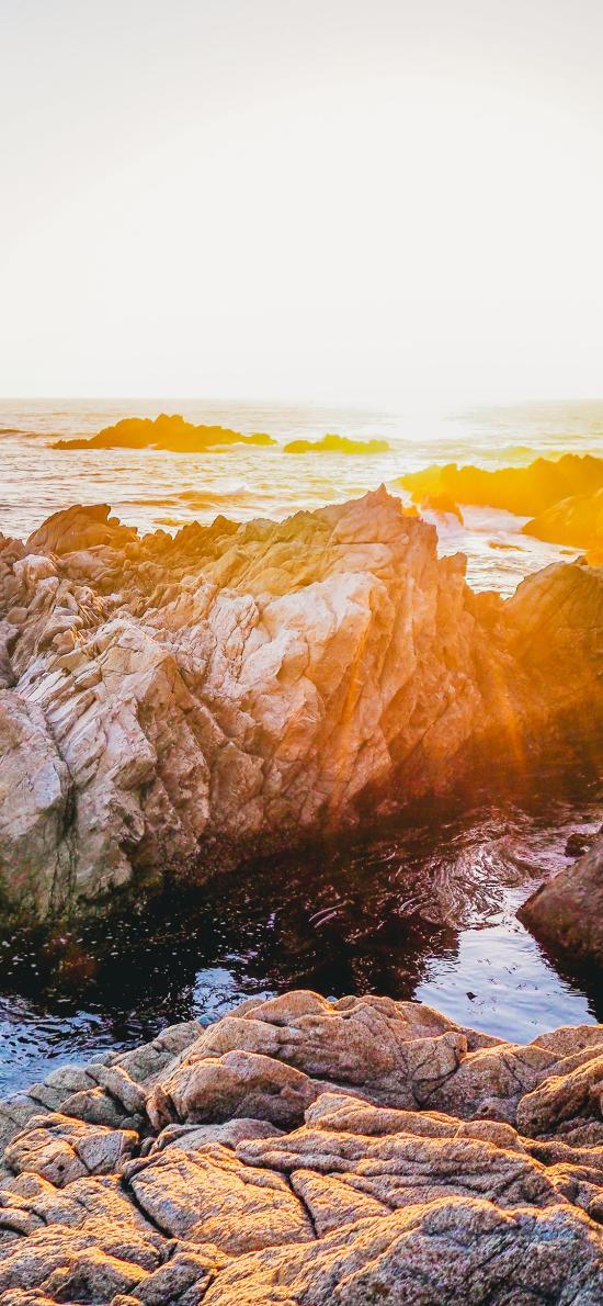 夕陽 海水 巖石 陽光